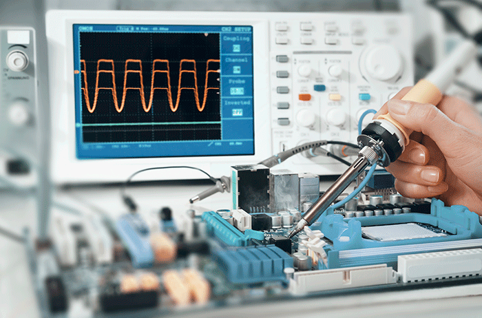 electronics case study scientist using oscilloscope