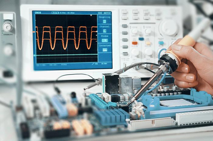 electronics case study scientist using oscilloscope